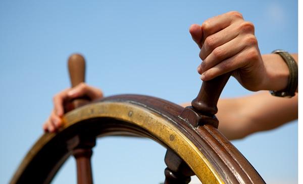 Hands on ship's rudder