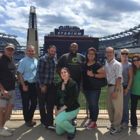 Picture of the Illumina Interactive team standing in front of Gillette Stadium