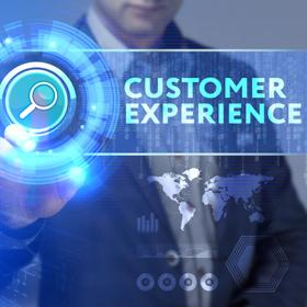 """A person in a suit selecting a button hovering in the air that says """"customer experience"""""""